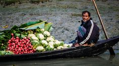 A vegetable seller on a floating market in Barisal