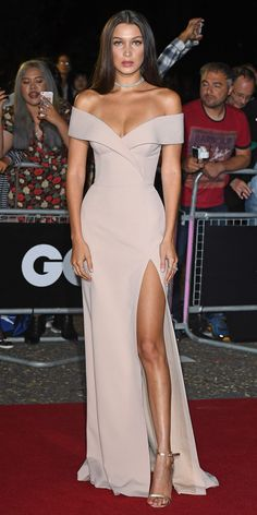 Bella Hadid turned heads at the 2016 GQ Men of the Year Awards and accepted the Hugo Boss Model of the Year award in a stunning bespoke blush off-the-shoulder crepe gown—a creation whipped up by Jason Wu for Boss. A double-stranded diamond choker and metallic sandals served as the finishing touches.