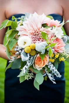 Stunning peach, coral, yellow and green bouquet by fleurish, photos by Laurel McConnell Photography | junebugweddings.com