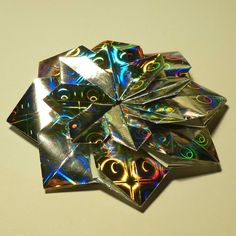 February 20th 2015 Origami mandala I made today. I used holographic paper for this design. #origami #paper #folding #mandala #modular #diy #craft #holographic #star #51