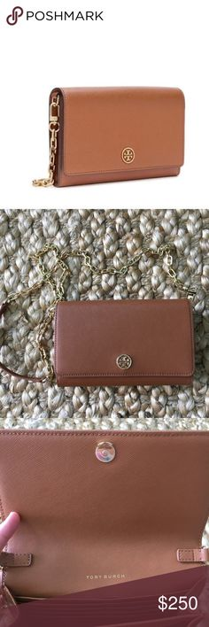 """NWT‼️ Authentic Tory Burch Robinson Wallet Chain Authentic and NWT Tory Burch Robinson wallet on chain Tigers eye tan leather brown satchel. Style 36905. Retail $295. Removable gain crossbody strap with a 21 inch drop, signature TB medallion on flap snap closure top,   Inside logo jacquard lining, 16 card slots, two bill slots, one zippered slot. Also, two open compartments. Measures 4""""H, 8""""W, 0.5""""D. Weighs approximately less than one pound. Gorgeous scratch resistant saffiano leather…"""