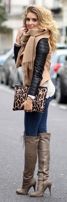 Fall style. Long high heels boots with jeans, black leather jacket with camel suede. Big scarf and animal print clutch. Fashion Trend.