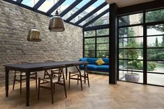 Extension Using Crittall Windows Refreshes Victorian Terrace House Contemporary dining area with cool pendant lights, brick wall and Crittal windowsContemporary dining area with cool pendant lights, brick wall and Crittal windows Victorian Terrace House, Victorian Homes, Victorian London, Crittal Doors, Crittall Windows, Glass Extension, Porch Extension, Rear Extension, Terraced House