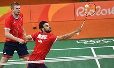 Chris Langridge returns a serve in the badminton.
