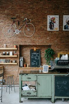 Interior Photography of a multifunctional space that hosts a cafe a hairdresser and a bike repairer.