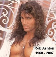 Rob Ashton, well known romance novel cover-model, passed away Monday, August 26, 2007 from complications due to an extended illness. This was very sad and unexpected news to many in the romance industry, and the news of Rob's death spread like wildfire within the romance writer and reader community.  Not only was Rob a hunky romance novel cover model, in 1995 he was voted Romantic Times Mr. Romance.