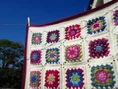 """""""Just for Me"""" blanket by Little Tin Bird.  A chatty blog post explaining her basic methods for the granny squares, slip stitch joining, & border for this lap blanket.  #crochet #afghan #throw"""