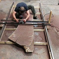 The Porter Cable is getting a workout today. #portercablerouter - - - - #urbntimbershop #dowoodworking #blackwalnutcrotch #walnutcrotch #liveedgedesign #ilovemyjob #columbusunderground #ohioexplored #woodnerd #handmadecbus #flatteningjig