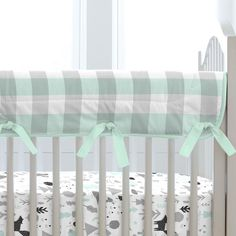 """A perfect solution to help protect your baby's crib while maintaining a stylish decor for your nursery. Our Crib Rail Cover is reversible, enabling you to change the visible side at a moment's notice. Simply wrap the cover around your crib rail, pull the ties though the buttonhole and tie. The crib rail cover measures approximately 50"""" long by 16"""" wide."""