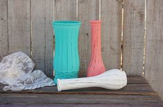 Set of 3 shabby chic vases hand painted a soft aqua, coral and white, lightly distressed, with a protective coating. They are not painted on