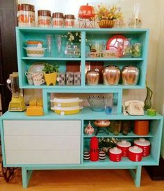 mid century modern finds ... love the pop of color inside the cabinet