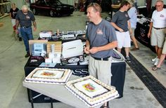 Classic Instruments owner John Mcleod is surrounded by treats, including a pair of birthday cakes and a few of the hundreds of items donated for the NSRA Appreciation Day charity raffle.  #PetoskeyArea  http://www.PetoskeyArea.com