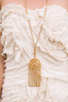 Long gold statement necklace | Rebecca Arthurs Photography | http://burnettsboards.com/2014/01/shipwreck-themed-wedding-inspiration-shoot-maui/