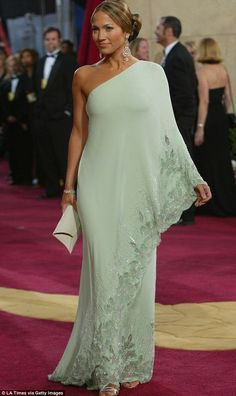 Lucky: Jennifer Lopez's mint green gown at the Oscars in 2003 had previously been owned by Jackie O As the annual couture fashion parade that is the Academy Awards approaches, we take a look back at some of the most memorable gowns of all time. Trendy Dresses, Elegant Dresses, Vintage Dresses, Fashion Dresses, Formal Dresses, Wedding Dresses, Casual Dresses, Vintage Dior, Office Dresses