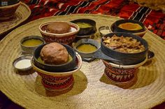 Najran's cuisine during winter in colorful traditional household utensils made of wicker and stone