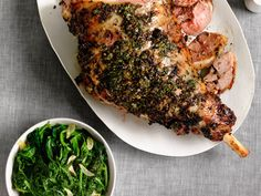 Herbed Leg of Lamb : Flavor the lamb with a paste made from scallions, parsley, dill, celery and garlic, then roast alongside turnips and scallions.