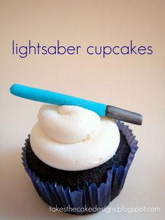 Chocolate Cupcakes with Vanilla Buttercream Icing complete with fondant lightsabers and stars to accompany the Star Wars Cake