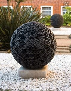These geometric, nature-inspired spheres made from hundreds of smooth river stones.