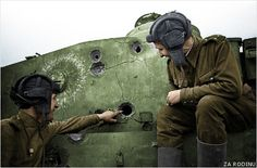 An Allied tank crew stops to study a rare knocked out German Tiger tank....