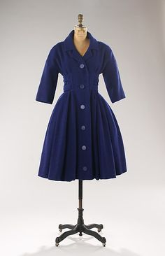 Coatdress Design House: House of Dior (French, founded 1947) Designer: Christian Dior (French, Granville 1905–1957 Montecatini) Date: 1957 Culture: French Medium: wool Dimensions: Length at CB: 41 in. (104.1 cm)
