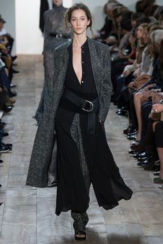 Michael Kors Fall 2014 RTW. #MichaelKors #Fall2014 #NYFW black billowing shirt dress over grey trousers with cinched waist. grey outerwear.