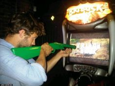 Jamie Dornan playing his favorite video game. Big Buck y'all.
