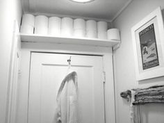 clever idea for toilet paper storage in a small bathroom.