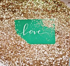 Placing your escort cards in a sea of glitter