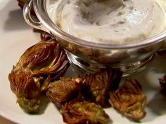 Fried Baby Artichokes from FoodNetwork.com  try with yogart dip  http://www.foodnetwork.com/recipes/yogurt-dip-recipe/index.html
