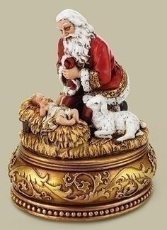 Adoring Santa With Baby Jesus on Ornate Base Plays Silent Night