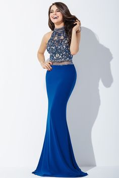 Created in fitted jersey, this Jovani JVN37862 prom dress features a beaded bodice with jewel neckline, cut-in shoulders and a sheer midriff. This gown has an illusion back and the full-length skirt with sweep train showcases a beaded waistline.