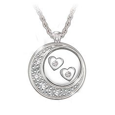 The extent of your love is out of this world! And now there's a delightful way to express it - with a gorgeous sterling silver and diamond pendant necklace that shines with the beauty of a curvaceous crescent moon and 6 genuine solitaire diamonds!  Entirely handcrafted in solid sterling silver, this diamond pendant necklace features an intriguing moon design with 4 glittering diamonds, encircling a pair of free-moving silver hearts - each with a sparkling diamond at its center.
