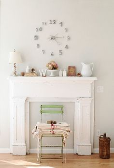 Love mantels. Really like the decor chosen, not sure about just having a random mantel attached to a wall with no fireplace though.