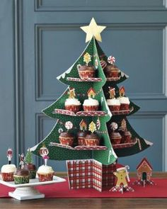 Christmas Cupcake stand::How hard could it be to make this out of wood, cardboard or even foamcore board? Santa Christmas, Christmas Movies, Christmas And New Year, All Things Christmas, Christmas Home, Christmas Crafts, Christmas Decorations, Holiday Decor, Christmas Dance