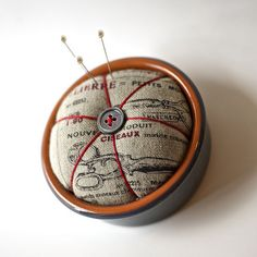 pincushion in a french cheese pot. linen and cotton fabric by suzuko koseki. What an amazing idea and useful. Lovely to pretty any craft room!
