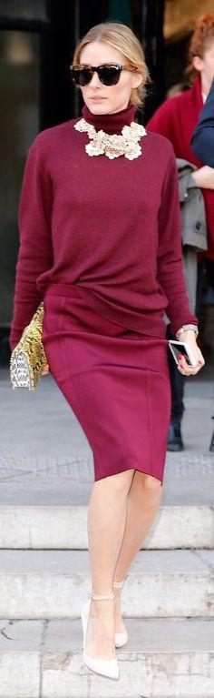 Olivia Palermo tucks her sweater into her skirt. Chic