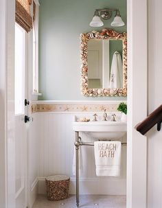 A shell-themed bathroom is appropriate in this bay front home. | Interior design by Julie Hovnanian