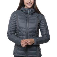 The Kuhl Women's Spyfire Hooded Down Jacket combines the superior warmth of 800-fill goose down with a form-following fit that eliminates that puffy look that's all too common among down jackets. The Precision 3D fit follows your body shape and eliminates binding along the seams inside the jacket. When combined with the slim baffling, the Spyfire gives a sleek and flattering silhouette that will pair well with everything from your favorite leggings to your tightest jeans. The main fab...