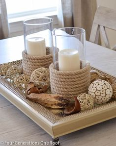 "See how I made my own sisal candle holders and used these from HomeGoods as my inspiration. Wrapping sisal around a glass candle holder is a great way to ""get the look"" on a budget. What a great coastal centerpiece! Diy Candle Holders, Diy Candles, Beeswax Candles, Decorating Candles, Diy Candle Stand, Nautical Candle Holders, Pillar Candles, Fireplace Candles, Candle Cups"