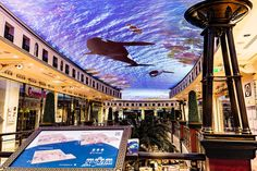 Das Schloss shopping centre has received an AV upgrade, with the world's largest projection ceiling immersing shoppers in the heart of Berlin Projection Installation, Projection Mapping, Mall Design, Retail Design, Weather Art, Digital Signage, Shopping Center, Under The Sea, The Magicians