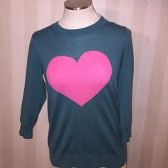 "J crew Valentine's Day pink heart real sweater top Cute sweater for Valentines day! Pretty teal with a large pink heart in the middle. Tippi sweater from j crew. Great condition. Bust across 15.5"" length 25.5"" J. Crew Sweaters Crew & Scoop Necks"