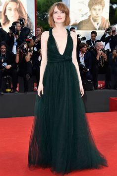 Emma Stone in a plunging tulle emerald green Valentino Couture gown.71st Venice International Film Festival.