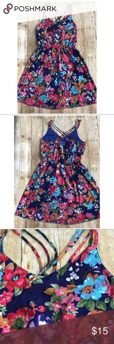 BNWOT Summer time dress *Brand new without tags *Fun and breathable summer dress *Criss cross straps on back  *100% polyester Speed Control New York Dresses