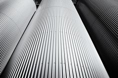Three silo's in Black and White.   Shot in low perspective.