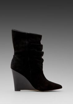 Slouched, wedge, pointy toe boot