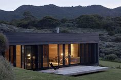 """Storm Cottage """"off the grid"""" on Great Barrier Island. Designed by Fearon Hay Architects based in Auckland, New Zealand. Completion: 2012."""