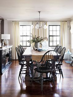 Draw attention to windows by painting their framework black instead of white, like the owner of this historic Massachusetts home.