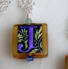 J is one of the most popular letters, here hand-colored in purple and green with jade and sodalite: