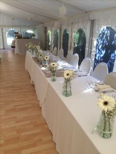Ivory Gerberas for the top table.