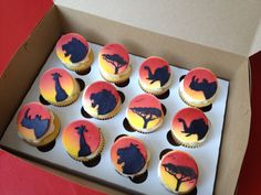 Lion King cupcakes. Airbrushed fondant toppers with hand cut fondant shadow animals. Hand drawn tree of life.
